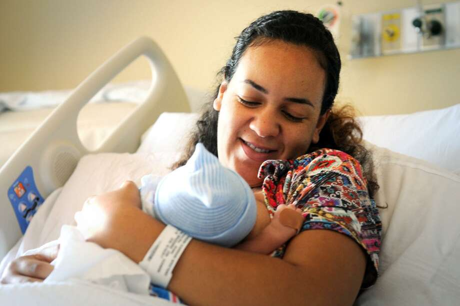 Ariane Moreira, of Stratford, nurses her son James in the Women's Care Center at Bridgeport Hospital, in Bridgeport, Conn. June 22, 2017. Photo: Ned Gerard / Hearst Connecticut Media / Connecticut Post