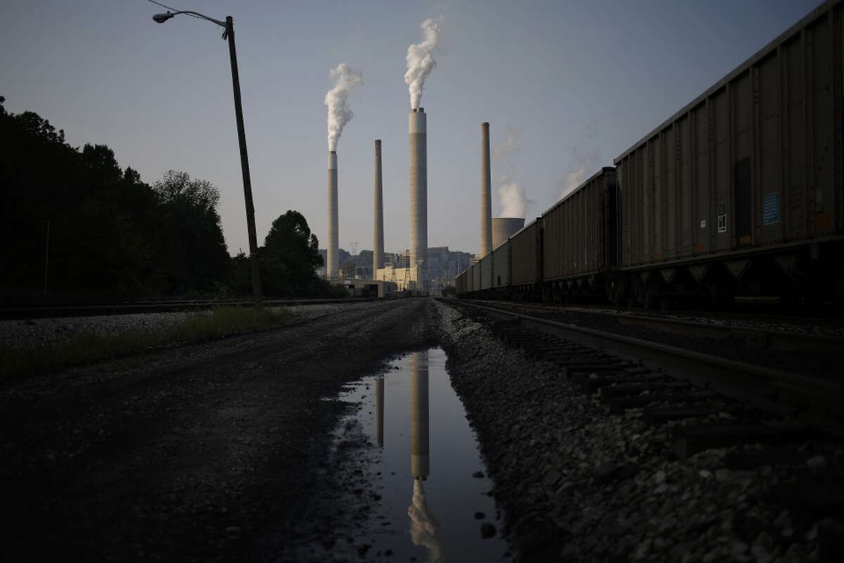 Emissions rise from the American Electric Power Co. Inc. coal-fired John E. Amos Power Plant in Winfield, W.Va., on July 31, 2014.