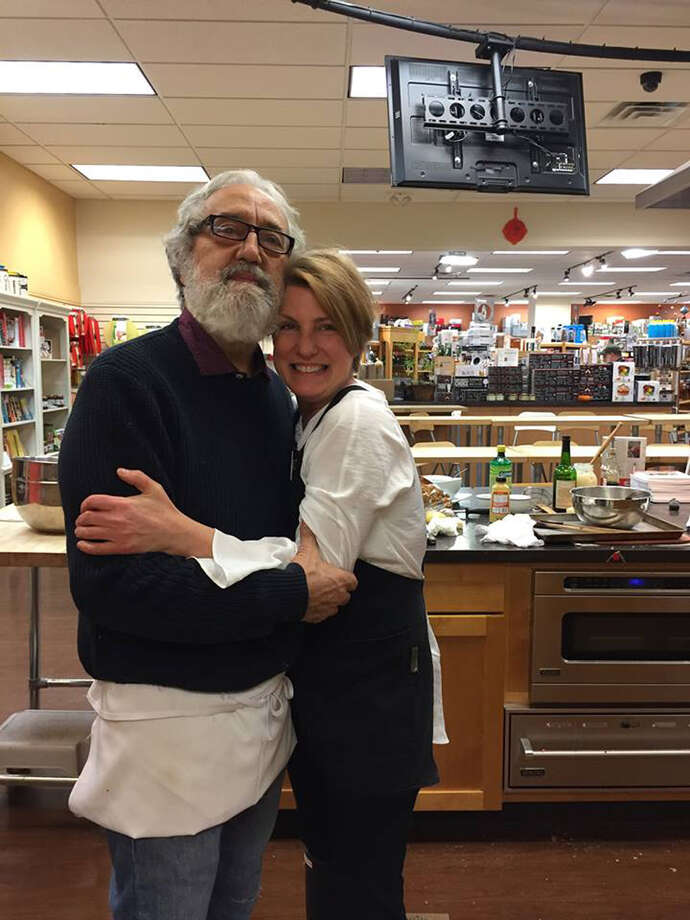 Michele Weiser with Jim Rua, chef-owner of Café Capriccio in Albany, in the kitchen for cooking classes at Different Drummer's Kitchen in Guilderland. (Photo via Facebook.) ORG XMIT: 25PCqRKI20V3EapUbrLJ