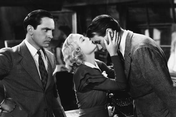 Gilda Farrell (Miriam Hopkins) kisses painter George Curtis (Gary Cooper) on the forehead as playwright Tom Chambers (Fredric March) looks angrily on in the 1933 comedy film Design for Living. (Photo by �� John Springer Collection/CORBIS/Corbis via Getty Images)