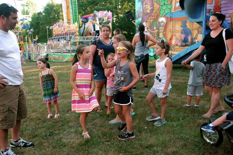 The Monroe Volunteer Fire Department's annual carnival on Fireman's Field at the Route 110 and 111 intersection in Monroe, Conn. begins Wednesday night, July 5, 2017. The carnival, which runs through Saturday from 6 p.m. to 11 p.m., features a range of amusement rides and games, as well as foods like burgers and hot dogs and plenty of sweet treats. File photo of the 2016 carnival. Photo: Christian Abraham / Hearst Connecticut Media / Connecticut Post
