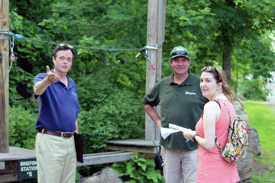 Anthony Wellman, Adventure Park marketing and communications director, Matt Kanaga, Adventure Park manager, and reporter Erin Kayata, at the Adventure Park on June 30, 2017, in Bridgeport, Conn. Photo: Justin Papp / Hearst Connecticut Media / Darien News
