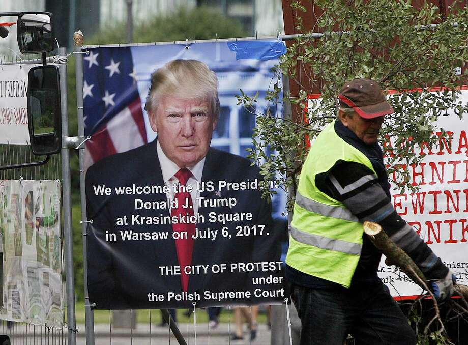 A poster advertising U.S. President Donald Trump's speech at the Krasinski Square on July 6, in Warsaw, Poland. U.S. President Donald Trump has broken with tradition in deciding to visit, Poland, an ex-communist country in Central Europe, before visiting Britain, France or Germany. Photo: Czarek Sokolowski / Associated Press / Copyright 2017 The Associated Press. All rights reserved.