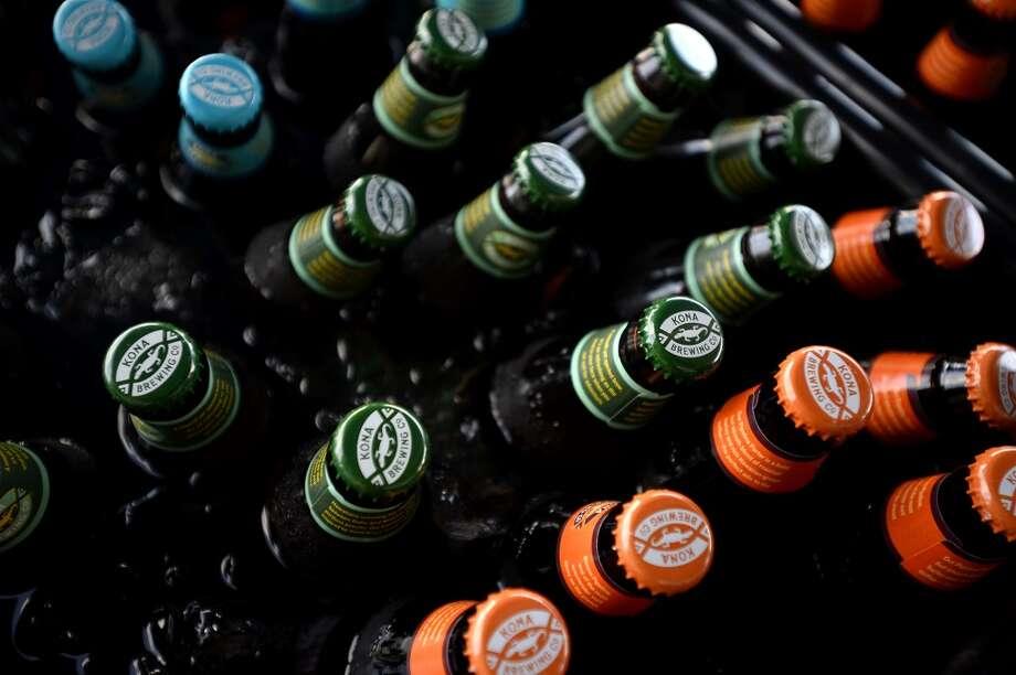 Beer bottles on ice during the Beaumont Craft Beer Festival. Photo: Ryan Pelham/The Enterprise
