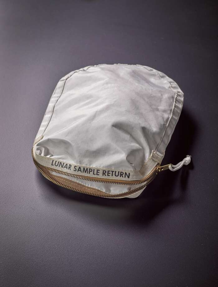 Apollo 11 Contingency Lunar Sample Return Bag  Used by Neil Armstrong on Apollo 11 to bring back the very first pieces of the moon ever collected – traces of which remain in the bag. The only such relic available for private ownership.Price Estimate: $2 - $4 million Photo: Sotheby's