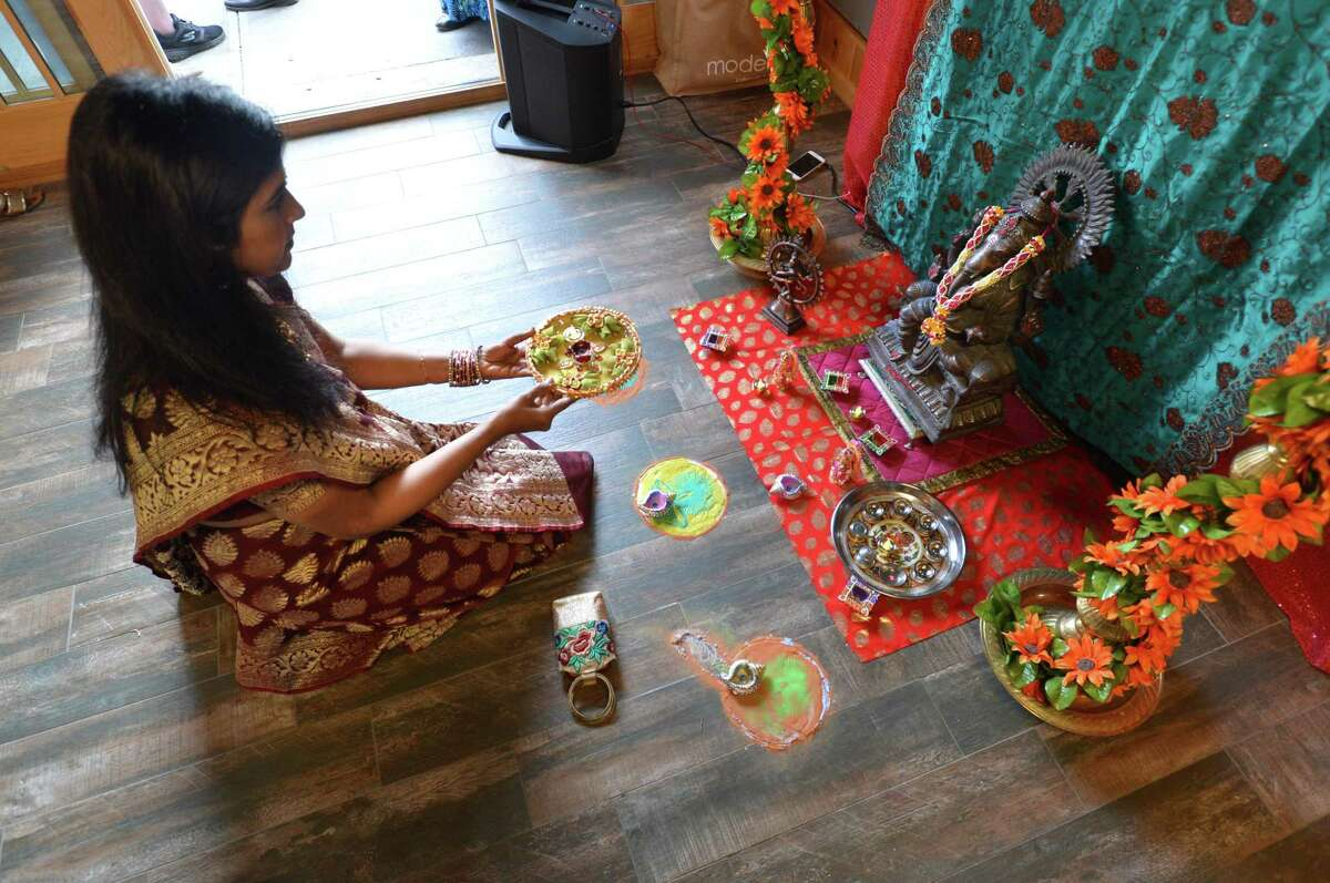 """Kiran Somaya gives a prayer to Ganesha at the """"Destination India"""" event at Fodor Farm on Thursday, June 15 in Norwalk. The event is the kick off reception for the second annual Norwalk International Cultural Exchange, NICE festival on July 8 at Oyster Shell Park in Norwalk"""