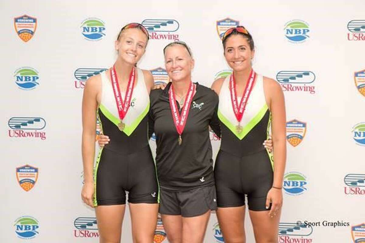 Kaitlyn Kynast of Ridgefield (left) and Julia Cornacchia of Darien pose with coach Liz Trond after taking the pairs gold medal at nationals.