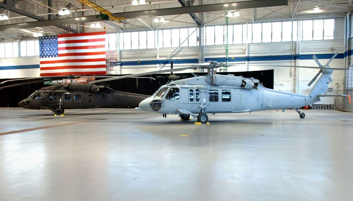 Sikorsky's UH-60M Black Hawk for the U.S. Army (left), and MH-60S Seahawk for the U.S. Navy (right), seen here in the Military Hangar at Sikorsky Aircraft in Stratford, Conn. Feb. 20, 2008.