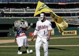 Oakland Athletics' Franklin Barreto has his face covered in shaving cream after hitting a solo walk-off home run to win the game 7-6 during the ninth inning of a baseball game against the Chicago White Sox, Tuesday, July 4, 2017, in Oakland, Calif. (AP Photo/Marcio Jose Sanchez)