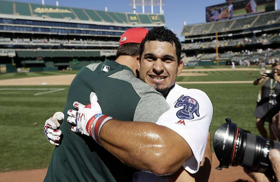 Oakland Athletics' Franklin Barreto, right, is hugged by a teammate after Barreto's walk-off home run to win the game 7-6 during the ninth inning of a baseball game against the Chicago White Sox, Tuesday, July 4, 2017, in Oakland, Calif. (AP Photo/Marcio Jose Sanchez) Photo: Marcio Jose Sanchez, Associated Press