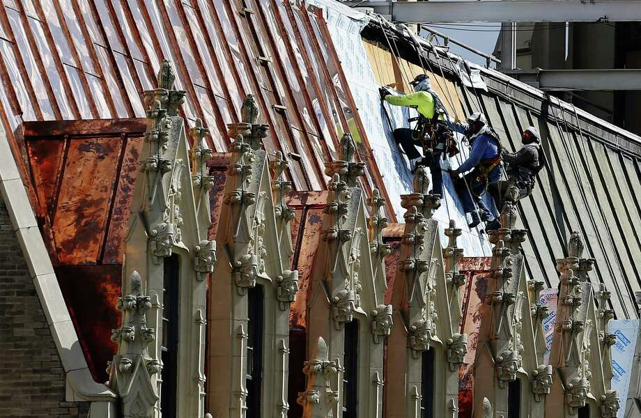 The new copper for the roof on the Emily Morgan Hotel, seen on June 28, 2017, is hauled up in rolls in one of the building's elevators. Photo: Kin Man Hui /San Antonio Express-News / ©2017 San Antonio Express-News
