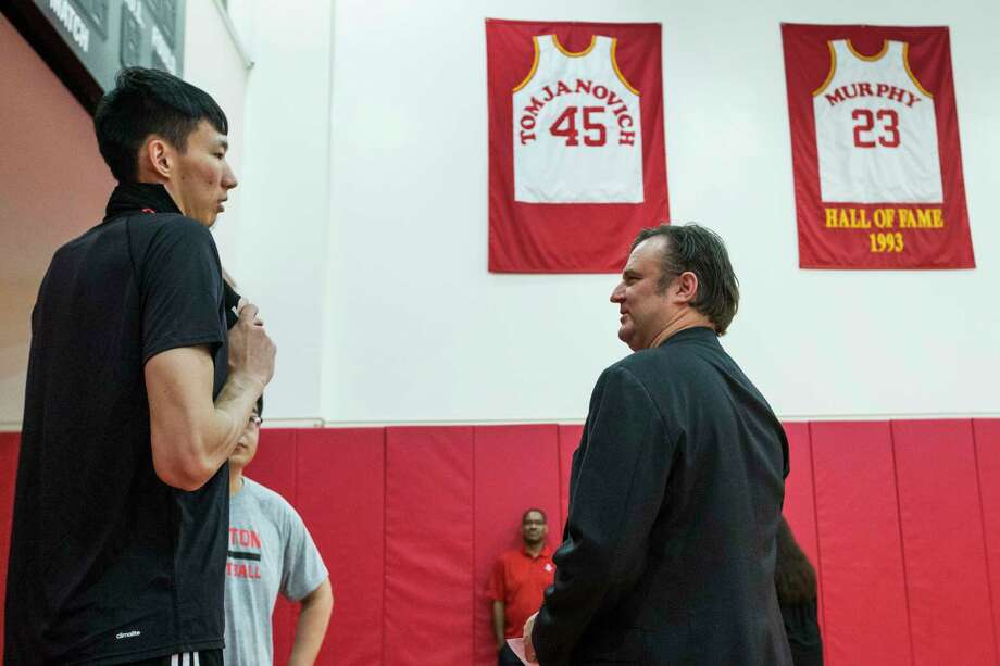 Houston Rockets center Zhou Qi, lett, talks to general manager Darryl Morey as he walks off the practice court following practice at the Rockets mini-camp in preparation for the NBA Summer League 2017 at Toyota Center on Wednesday, July 5, 2017, in Houston. Photo: Brett Coomer, Houston Chronicle / © 2017 Houston Chronicle