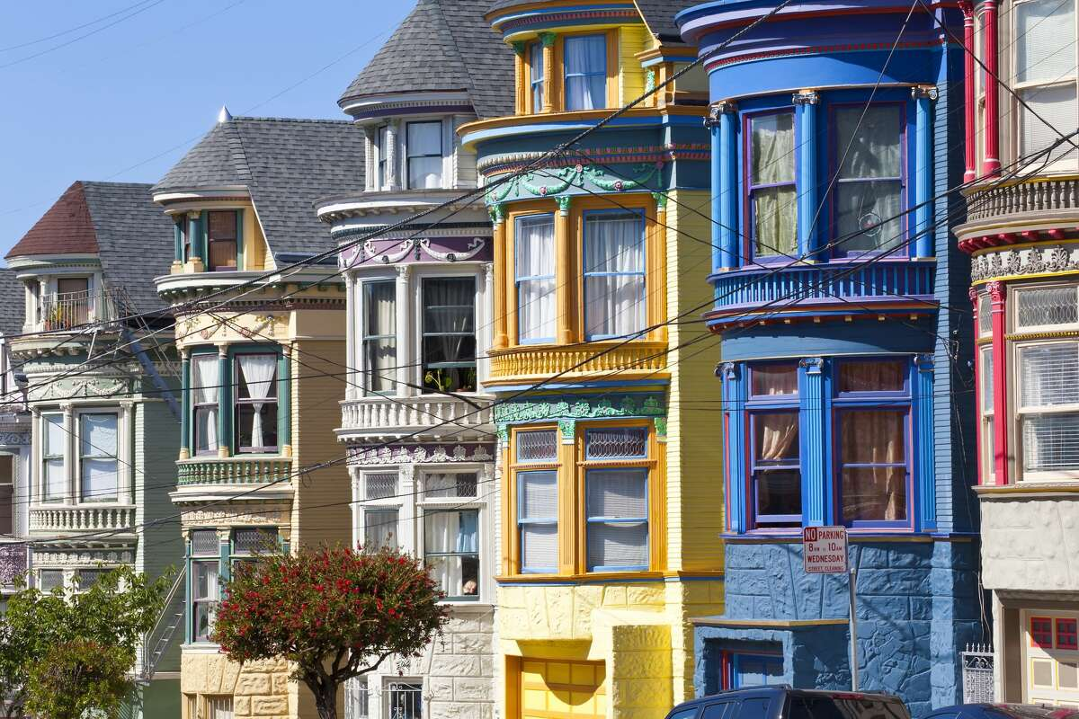 Colourfully painted Victorian houses in the Haight-Ashbury district of San Francisco, California, USA