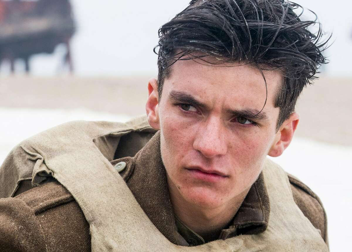 """Up close and personal Writer-director Christopher Nolan's """"Dunkirk"""" is shot on a massive scale - literally, as 70 percent of it was captured in giant IMAX format - but the auteur aims for an """"intimate epic."""" Newcomer Fionn Whitehead (pictured) leads a cast including Tom Hardy, Cillian Murphy, Kenneth Branagh and Oscar winner Mark Rylance. Photo by Melinda Sue Gordon / Courtesy Warner Bros. Entertainment"""