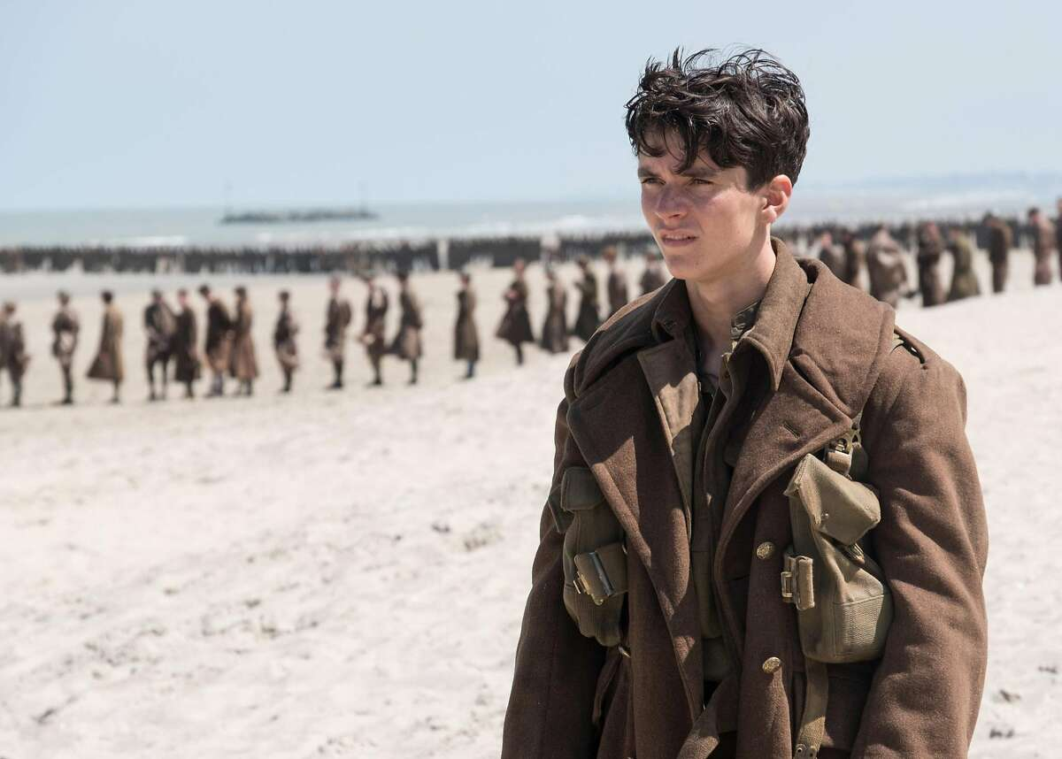 """Not in line """"Dunkirk,"""" starring newcomer Fionn Whitehead (only one mini-series credit before this feature) tells the story of the attempted evacuation of hundreds of thousands of British soldiers from a French beach in the early days of World War II. It's not your typical war movie: It's shot entirely in large format, it uses unusual narrative devices and it's written and directed by Christopher Nolan. Photo by Melinda Sue Gordon / Courtesy Warner Bros. Entertainment"""
