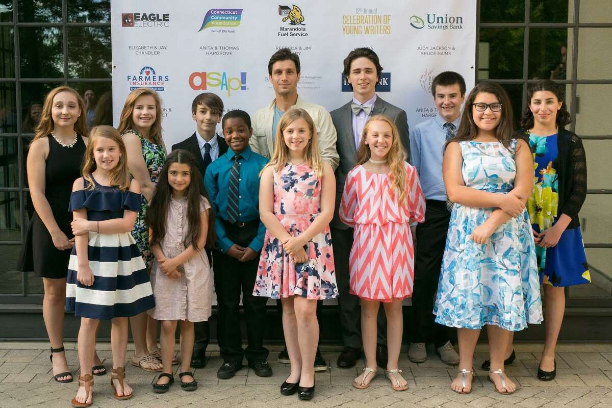 """The After School Arts Program in Washington recently hosted its 12th annual """"Celebration of Young Writers"""" at The Gunnery in Washington. Shown above are, in front, Reese Evans, Maya Woodhall, Xavier Williams, Charlotte Blair, Sophia Granata and Illianna Martinez and, in back, Ciara Lynch, Elaina Stumpf, Nico Sorce, Michael Lombardi, Dean Saccardi, Carter Orr and Sara El Moustakim."""