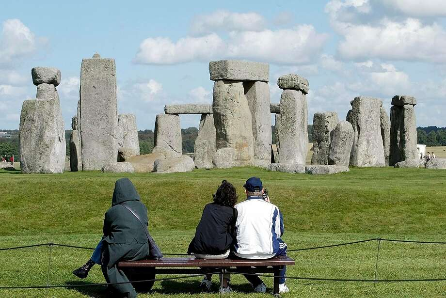 ** FILE ** Tourists look at The Stonehenge landscape of Salisbury Plain in England, Sept. 15, 2004. Stonehenge is among 21 candidates for the new seven wonders of the world. The seven winners will be announced July 7, 2007 in Lisbon, Portugal. (AP Photo/Dave Caulkin) Photo: DAVE CAULKIN, AP