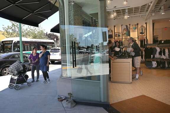 Pedestrians (left) pass by Lululemon on Tuesday, June 27, 2017, in west Berkeley�s Fourth Street retail district in Berkeley, Calif.