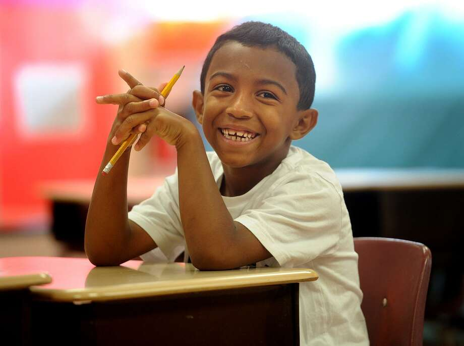 Victor Nieves, 6, has a big smile as he starts his first day with his third grade class in the Lighthouse summer program at Luis Munoz Marin School in Bridgeport, Conn. on Wednesday, July 5, 2017. The city Board of Education narrowly approved the program, a fixture in city schools since it's founding in 1993. Photo: Brian A. Pounds / Hearst Connecticut Media / Connecticut Post