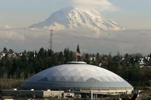 The Tacoma dome takes it's place below Mt Rainier in Tacoma, Wash., Monday, Feb. 12, 2001. While many cities around the country are moving away from covered facilities, the Tacoma Dome holds it's own. (AP Photo/John Froschauer)