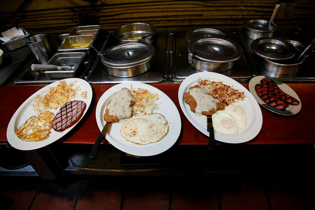 Egg and hash dishes sit on a counter to be delivered to guests during breakfast at the diner in San Francisco.