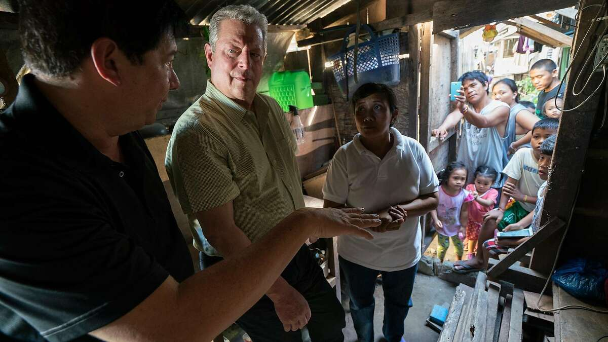 """Former Vice President Al Gore (center) goes on a worldwide tour to spread the message of global warming in """"An Inconvenient Sequel: Truth to Power."""""""