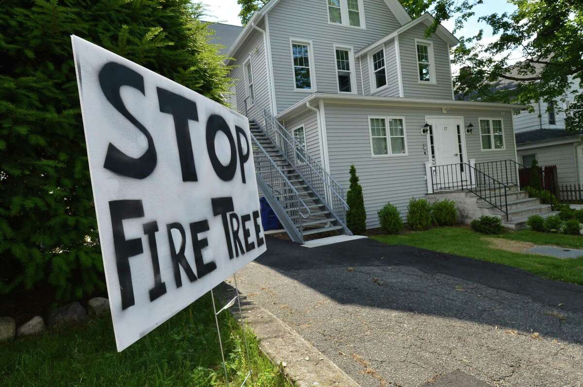 A sign on the property next to 17 Quintard Ave., the site of a proposed halfway house.