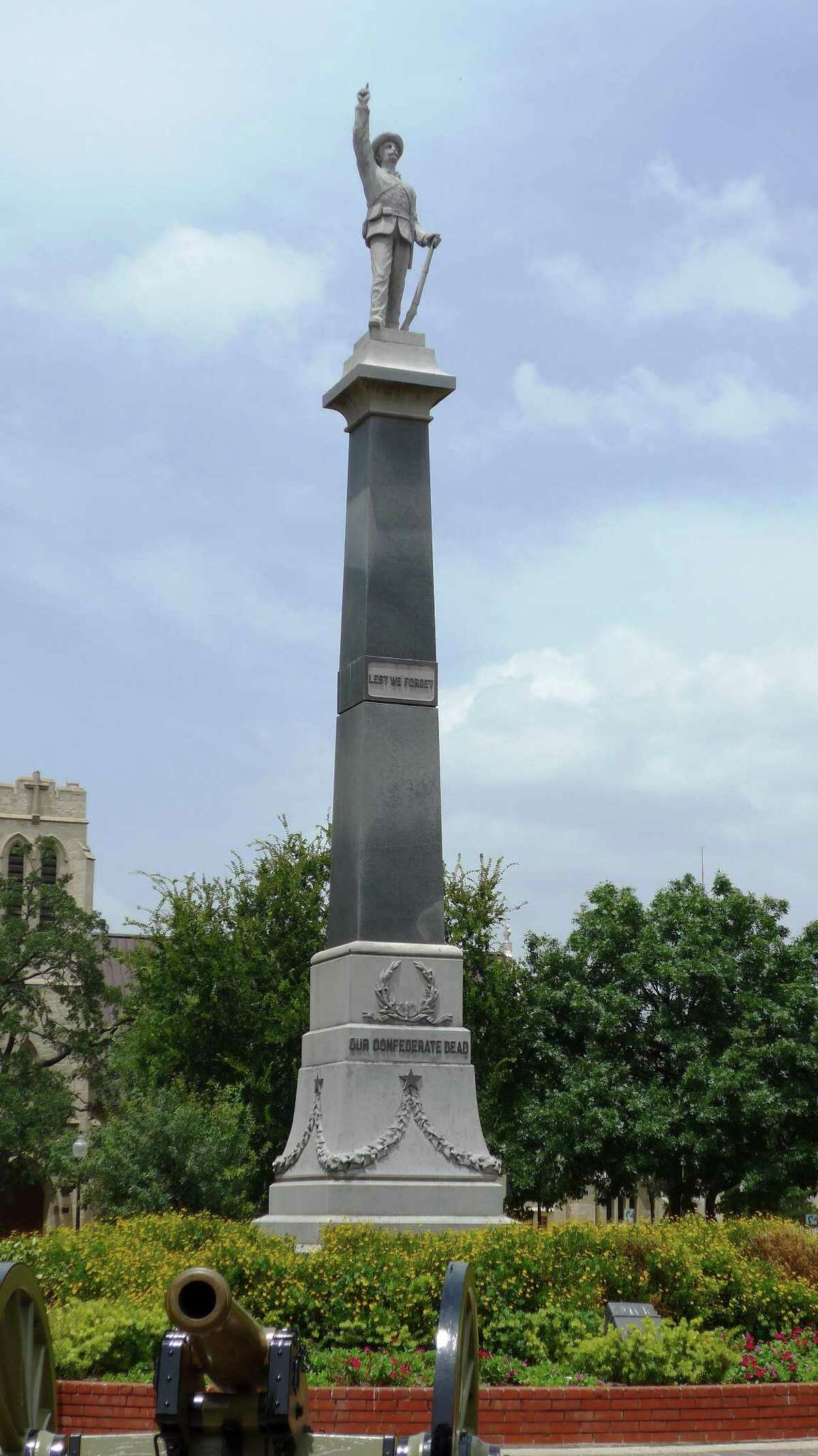 """A monument to Confederate war dead, erected in city-owned Travis Park in 1899, says """"Lest We Forget"""" and """"Our Confederate Dead."""" Shown Wednesday, July 8, 2015."""