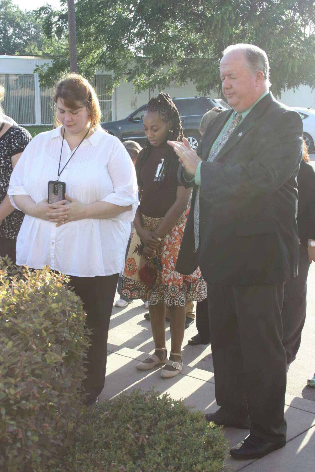 Hospital CEO Don Vickers prays for God's blessings on the Cleveland community and the Texas Rural Hospital, formerly known as Cleveland Regional Medical Center, on Wednesday, July 5. The hospital building located at 300 E. Crockett St. has sat dormant for three years after previous owners closed the hospital abruptly in August 2014.