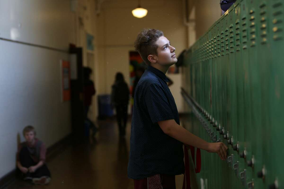 SailorHank Payne opens his locker at the end of the day, on one of his final days of middle school. (Genna Martin, seattlepi.com)