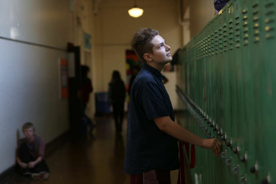 SailorHank Payne opens his locker at the end of the day, on one of his final days of middle school. (Genna Martin, seattlepi.com) Photo: GENNA MARTIN/SEATTLEPI.COM