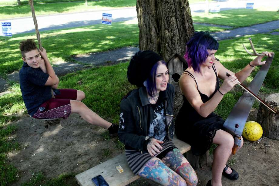SailorHank Payne sits on a rope swing as artists and family friends Bree Rose and Gale Force chat with his mom, June 2, 2017. Payne grew up surrounded by artists and eccentrics who helped shape his current passions and art. (Genna Martin, seattlepi.com) Photo: GENNA MARTIN/SEATTLEPI.COM