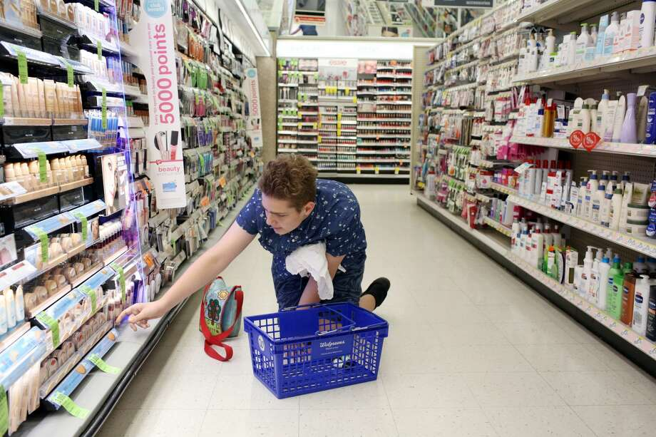 SailorHank Payne shops for make up at Walgreens, June 13, 2017. He saved up birthday money to buy the products, but hopes for an endorsement deal someday from a make up company.   (Genna Martin, seattlepi.com) Photo: GENNA MARTIN/SEATTLEPI.COM
