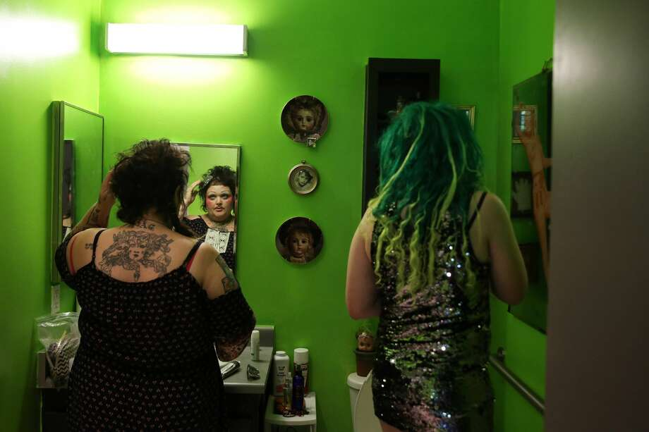 SailorHank Payne, right, and his mother, artist Kook Teflon, get ready in the bathroom before RainbowGore Cake performs in a drag competition hosted by The Boulet Brothers at Capitol Hill Pridefest, June 24, 2017. (Genna Martin, seattlepi.com) Photo: GENNA MARTIN/SEATTLEPI.COM