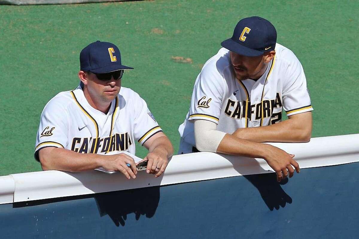 Then-Cal pitching coach Mike Neu with pitcher Ryan Mason