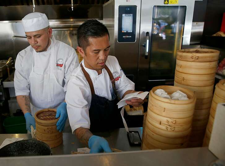Executive chef Edgar Agbayani works on orders at Dumpling Time on Friday, June 30, 2017, in San Francisco, Calif.