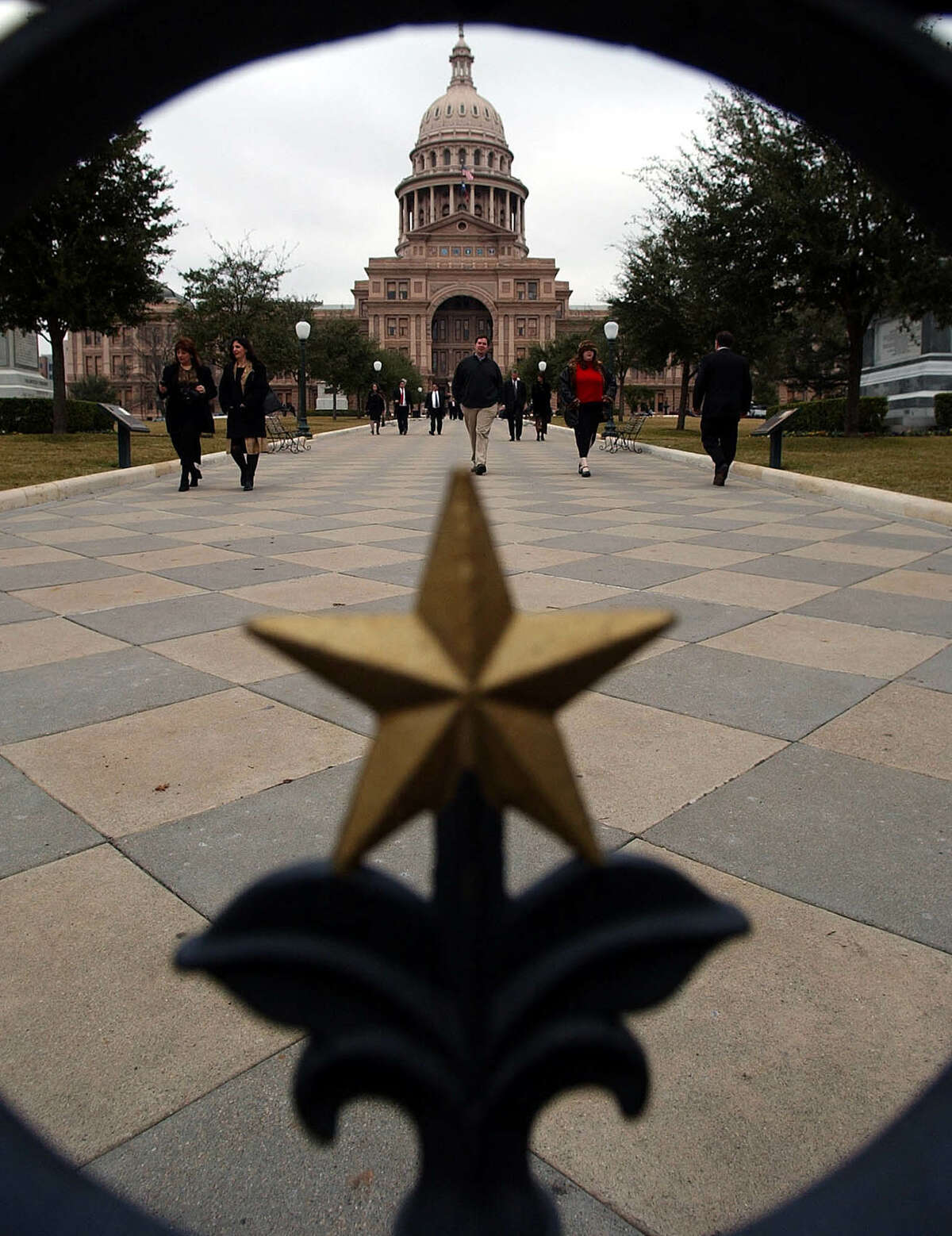 People are seen exiting the state capitol in Austin. (File Photo)