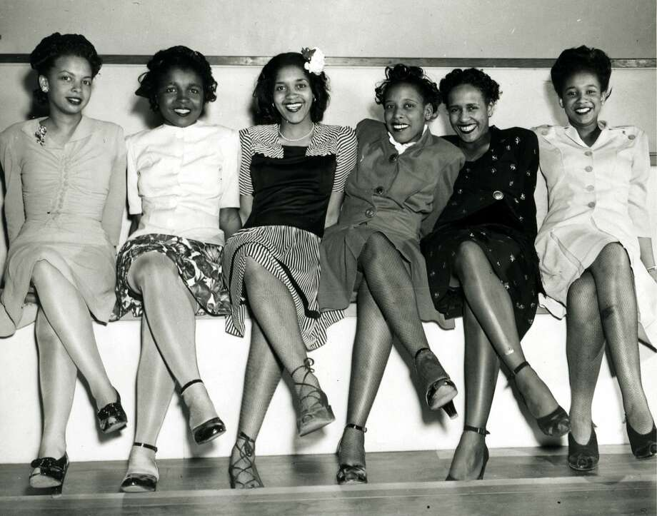 Group portrait of pin-up girls smiling while attending the Spring Formal Dance at the Naval Air Station in Seattle, WA, April 1944. (Photo by PhotoQuest/Getty Images) Photo: PhotoQuest/Getty Images