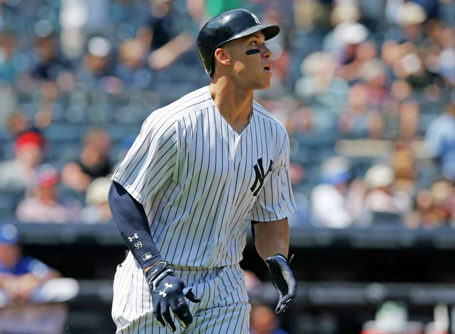 New York Yankees' Aaron Judge watches his two-run home run in the fourth inning of a baseball game against the Toronto Blue Jays in New York, Wednesday, July 5, 2017. (AP Photo/Kathy Willens) ORG XMIT: NYY110 Photo: Kathy Willens / Copyright 2017 The Associated Press. All rights reserved.