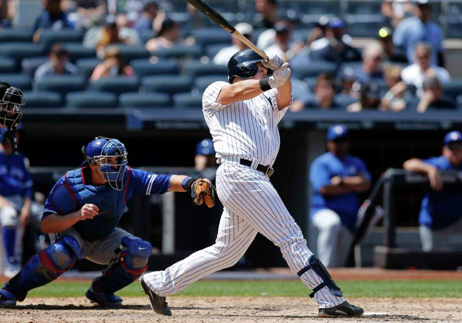 New York Yankees' Ji-Man Choi hits a solo home run during the fifth inning of a baseball game against the Toronto Blue Jays in New York, Wednesday, July 5, 2017. Toronto Blue Jays catcher Miguel Montero is behind the plate, left. (AP Photo/Kathy Willens) ORG XMIT: NYY113 Photo: Kathy Willens / Associated Press