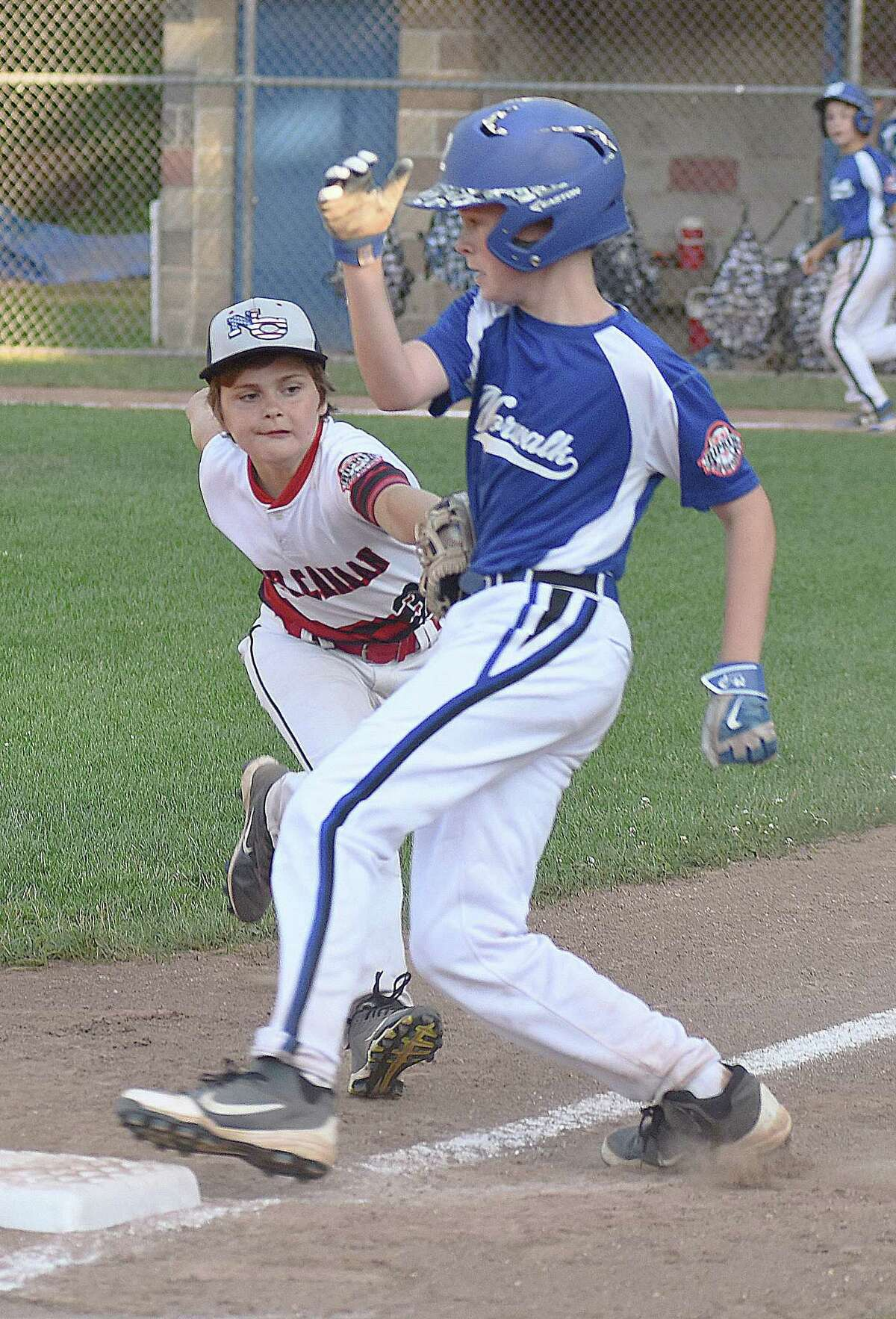 Norwalk's Kyle Close, right, looks to get back to the bag as New Canaan third baseman Salty Balkun makes the tag during Wednesday's District 1 Cal Ripken 11-year-old All-Stars championship game at Tim Devine Field in Norwalk. Close was called safe on the play and Norwalk went on to win 10-0.