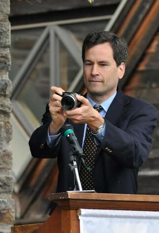 David Pogue, New York Times Technology Columnist, takes a panoramic photograph during Greens Farms Academy eighty-fifth commencement on Thursday, June 10, 2010. Pogue and his wife were charged with disorderly conduct following a domestic dispute Monday at their Westport home that police said turned physical. Photo: Amy Mortensen / Connecticut Post Freelance