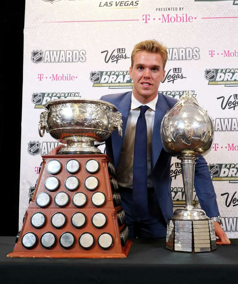 LAS VEGAS, NV - JUNE 21:  Connor McDavid of the Edmonton Oilers poses with the Art Ross Trophy, Hart Memorial Trophy and the Ted Lindsay Award after the 2017 NHL Awards and Expansion Draft at T-Mobile Arena on June 21, 2017 in Las Vegas, Nevada.  (Photo by Bruce Bennett/Getty Images) ORG XMIT: 700065354 Photo: Bruce Bennett / 2017 Getty Images