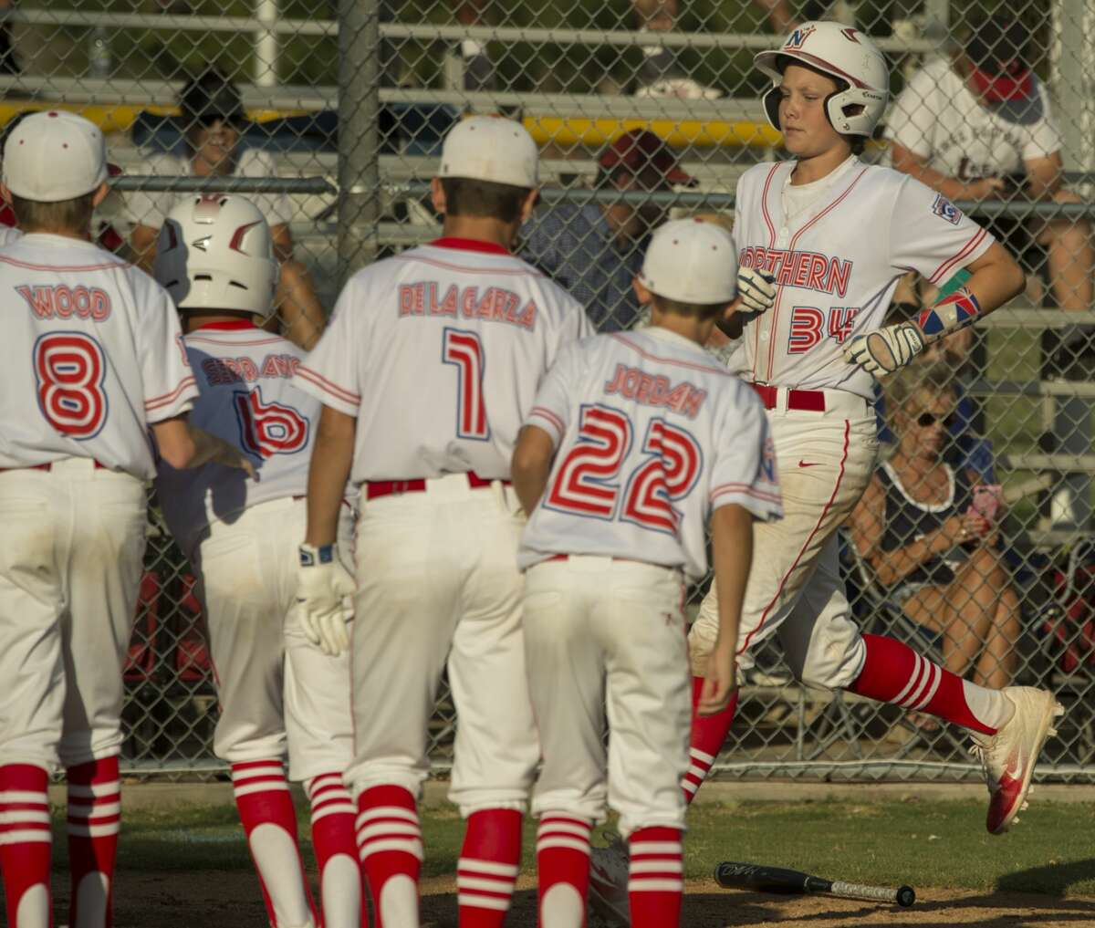 Midland Northern team members congratulate Chase Shores as he crosses home on a home run 7/05/17 against Lubbock Western in the Texas West Section 1 10-12 year old playoff game at John P. Butler Sports Complex. Tim Fischer/Reporter-Telegram
