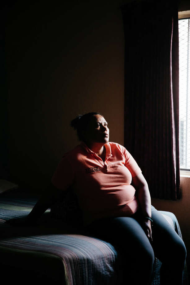 Nohemy Alvares, in a hotel room in Nogales, Sonora, Mexico, traveled with a  caravan in search of her son, Gilver, who disappeared three years ago.  Photo: Julysa Sosa, Freelance / ©2016 San Antonio Express-News