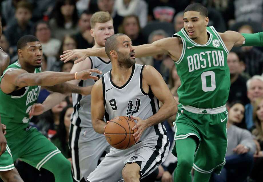 San Antonio Spurs guard Tony Parker (9) is pressured by Boston Celtics forward Jayson Tatum (0) as he looks to drive to the basket during the second half of an NBA basketball game Friday, Dec. 8, 2017, in San Antonio. San Antonio won 105-102. (AP Photo/Eric Gay) Photo: Eric Gay, Associated Press / Copyright 2017 The Associated Press. All rights reserved.