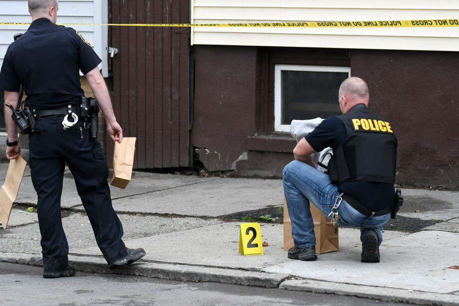 Police gather evidence in front of 528 First Street following a shooting on Tuesday afternoon, May 2, 2017, in Albany, N.Y. A 26-year-old male was shot in the leg. (Will Waldron/Times Union) Photo: Will Waldron / 20040403A
