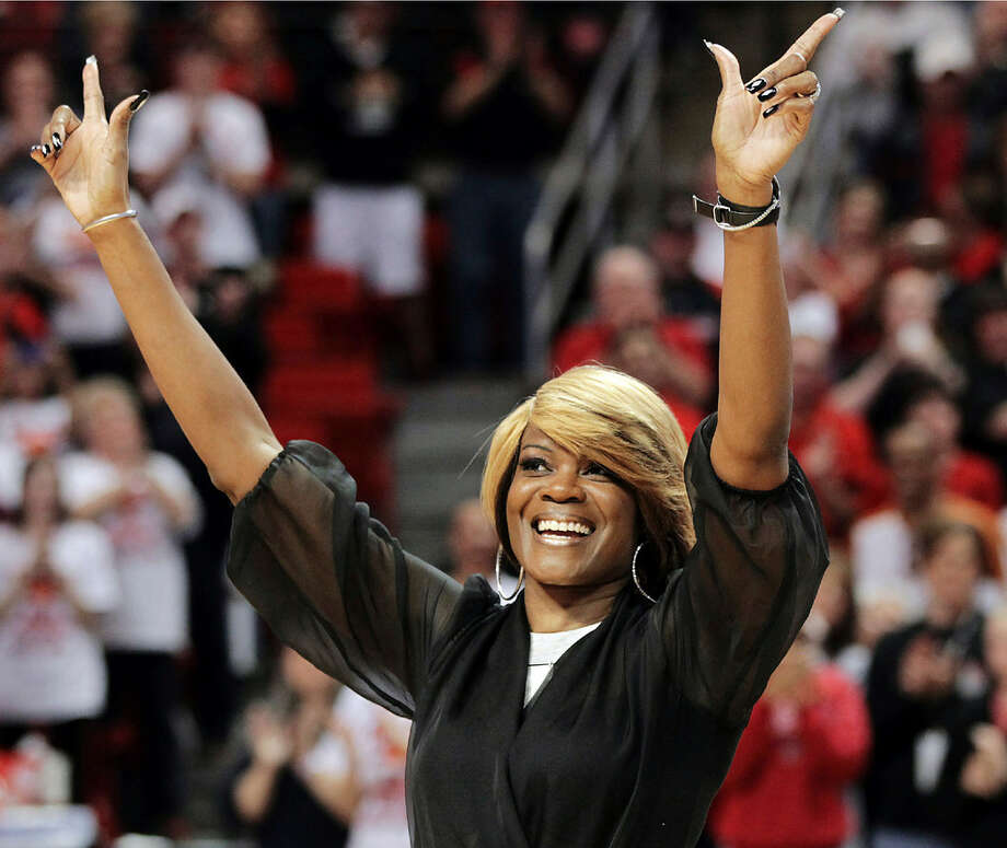 In this Feb. 17, 2013, file photo, Sheryl Swoopes acknowledges the crowd during a ceremony to honor the 1993 Texas Tech national championship team at an NCAA college basketball game between Texas Tech and Texas in Lubbock, Texas. (AP Photo/The Avalanche-Journal, Zach Long, File)