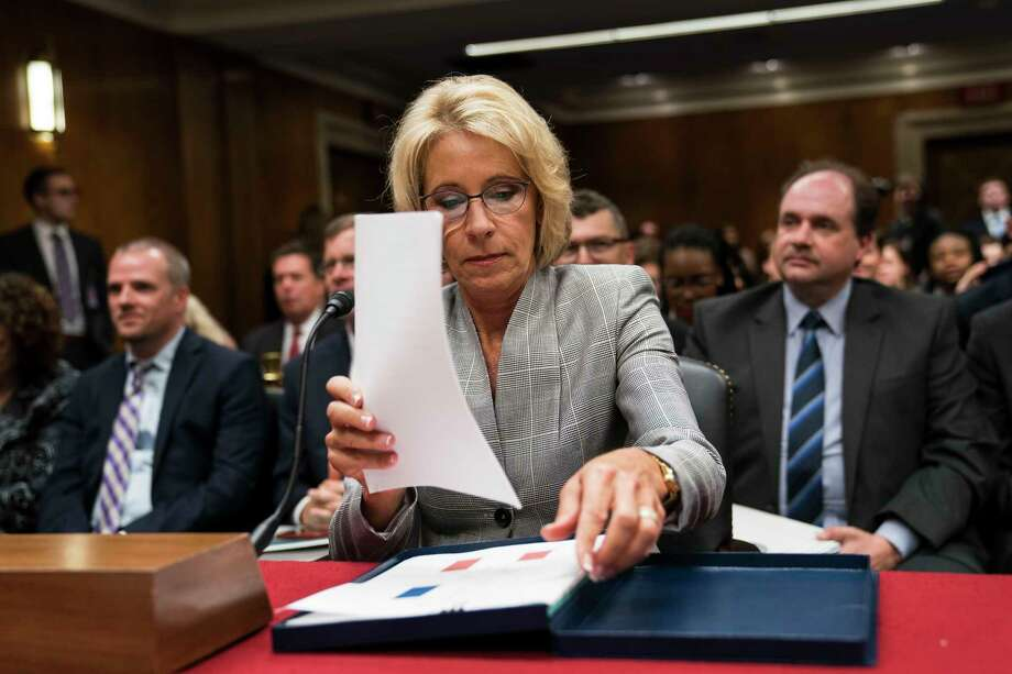 FILE — Education Secretary Betsy DeVos testifies on Capitol Hill in Washington, June 6, 2017. The Department of Education is scaling back investigations into civil rights violations at the nation's public schools and universities, easing off mandates imposed by the Obama administration.  (Doug Mills/The New York Times) ORG XMIT: XNYT178 Photo: DOUG MILLS / NYTNS