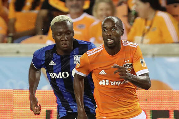 Houston Dynamo defender DaMarcus Beasley (7) looks up for a pass while Montreal Impact forward Ballou Jean-Yves Tabla (13) gives chase during the second half of an MLS soccer match Wednesday, July 5, 2017, in Houston. (Yi-Chin Lee/Houston Chronicle via AP)